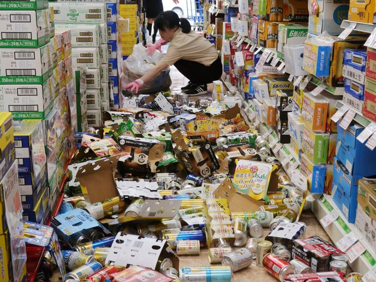 Shop items litter the floor of a convenience store, following the earthquake in Hirakata, Osaka