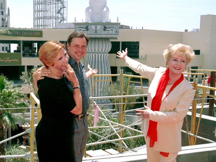 Actress Debbie Reynolds (right) posing with her children Carrie and Tod Fisher in Hollywood in 2001