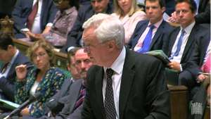 a group of people standing in front of a crowd: Mr Davis urged MPs to accept that the Brexit Bill now had to complete its passage through the Houses of Parliament