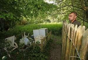 a man sitting on a bench in a garden: 19-jun-nh-hampstead-heath-031E.JPG.jpg