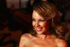 Kylie Minogue smiling for the camera: Minogue has a career spanning multiple decades (Gareth Cattermole/)