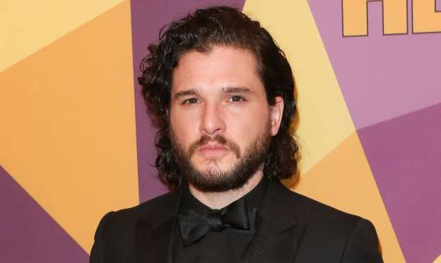 Kit Harington wearing a suit and tie