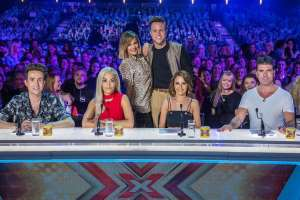 a group of people posing for the camera: In 2015 Olly joined the new line-up of the X Factor, which lasted just one year