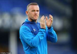 Wayne Rooney holding the hands up: Steven Gerrard has urged Wayne Rooney to leave Everton and make the switch to the MLS