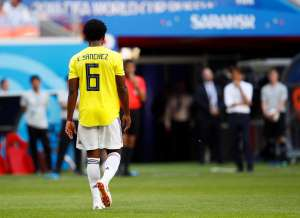Colombia's Carlos Sanchez walks off after being sent off