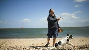 a man and a dog on a beach: Local MPs Gather Support For A Second Referendum Two Years After The Brexit Vote