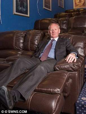 a person sitting on a leather couch: The grandfather-of-five claims he thought he did not need permission when he started construction but council officials said the expensive project breached planning laws