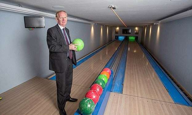 a man standing in a room: Graham Wildin, 66, caused outrage when he built the 10,000sq/ft leisure centre, complete with a bowling alley, at his home in Cinderford, Gloucestershire