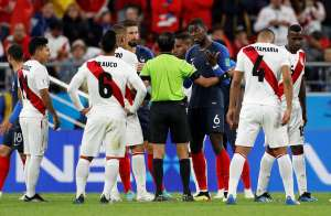 Soccer Football - World Cup - Group C - France vs Peru - Ekaterinburg Arena, Yekaterinburg, Russia - June 21, 2018   France's Paul Pogba remonstrates with referee Mohammed Abdulla Hassan              REUTERS/Darren Staples
