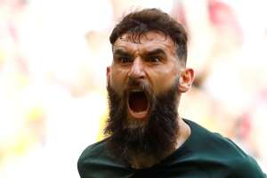 Australia's Mile Jedinak celebrates scoring their first goal