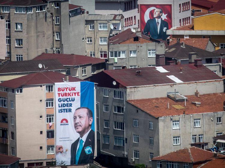 Election posters show Turkey's President Recep Tayyip Erdogan, left, and Mustafa Kemal Ataturk