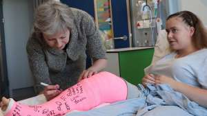 Let us imagine the UK prime minister would admit that with an ageing population and public services squeezed, higher taxes were always going to be necessary: Britain's Prime Minister Theresa May signs the plaster cast of 15-year-old Jade Myers, who broke her leg falling off a wall, during her visit to the Royal Free Hospital in London on June 18, 2018. Prime Minister Theresa May on Sunday promised a major funding boost for Britain's state-run National Health Service, using money currently sent to the EU. The premier said that by the financial year 2023-2024, an extra £20 billion ($26.5 billion, 23 billion euros) a year would be going into the NHS. / AFP PHOTO / POOL / Dan KitwoodDAN KITWOOD/AFP/