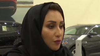 A woman prepares to buy a car in Saudi Arabia