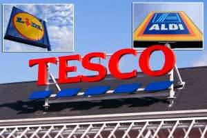 a close up of a sign: All change please - Tesco is on a mission to revamp its shelves