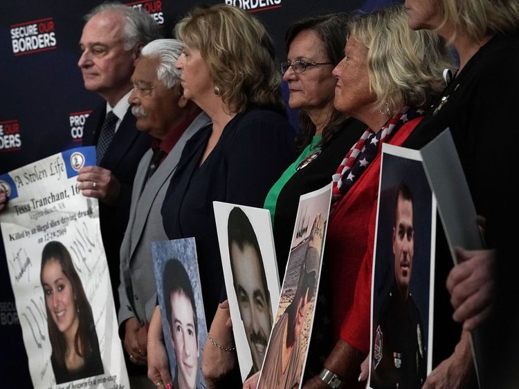 Family members hold portraits of their deceased loved ones that were signed by President Donald Trump during an event with 'Angel Families' June 22, 2018