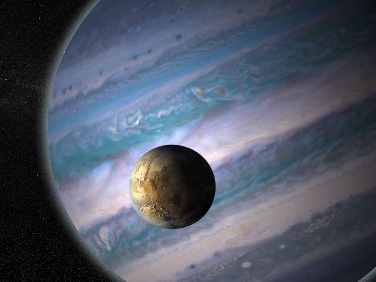 Credit: Artist's illustration of a potentially habitable exomoon orbiting a giant planet in a distant solar system. Credit: NASA GSFC: Jay Friedlander and Britt Griswold.