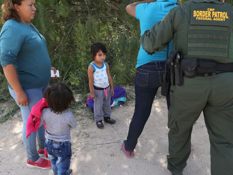 Border Patrol agents take Central American asylum seekers into custody near McAllen, Texas
