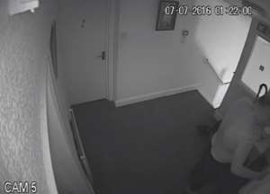 Handout CCTV still issued by Avon and Somerset Police of Jeffrey Barry knocking on the door of Kamil Ahmad's flat