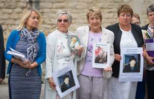 Members of the families of people who died at Gosport War Memorial Hospital outside Portsmouth Cathedral after the disclosure of the Gosport Independent Panel's report.