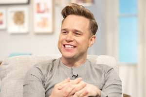 Olly Murs smiling for the camera: Olly was in talks for a job on the panel