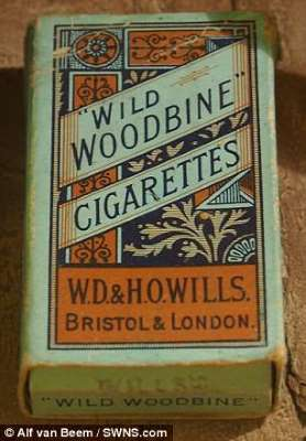 a close up of a sign: Woodbines, which were strong and unfiltered, were not widely available on the Western Front and were considered as gold dust in the trenches