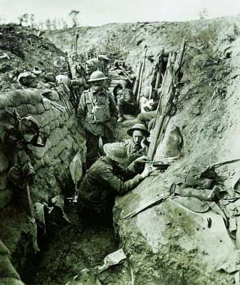 a group of people on a rock: His selfless bravery, particularly at the Battle of Messines (file photo above, in 1917), earned him a Military Cross from King George V and the affectionate, lasting nickname, 'Woodbine Willie'