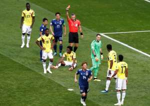 Colombia's Carlos Sanchez is shown a red card by referee Damir Skomina
