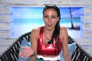 a woman sitting on a bench posing for the camera: She was on Love Island in 2016