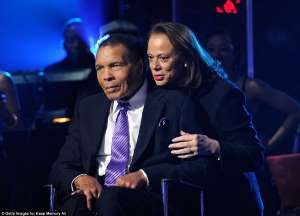 Muhammad Ali wearing a suit and tie talking on a stage: Lonnie (pictured with Ali in 2012) made the decision to sell the home two years after he died of septic shock
