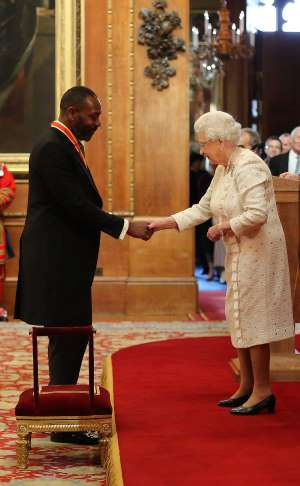 Sir Lenny Henry is awarded a Knighthood by Queen Elizabeth II during an Investiture ceremony at Windsor Castle.