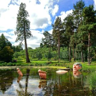 The giant sleeping in a lake at the Alnwick Garden in Northumberland