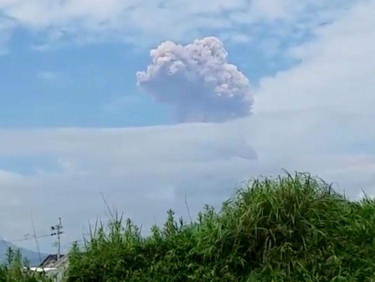 Shinmoedake peak erupting between Miyazaki and Kagoshima prefectures in southwestern Japan