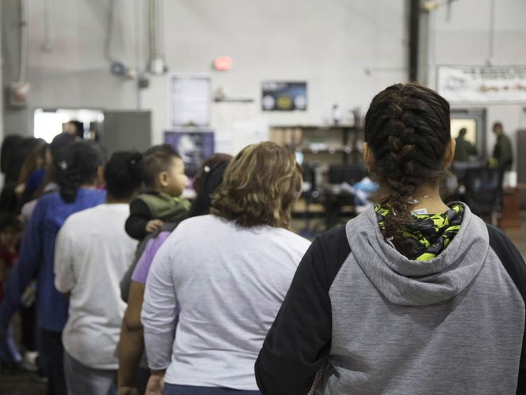 Women stand in line at the McAllen facility in Texas