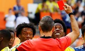 Carlos Sánchez (right) is sent off in Colombia's defeat against Japan.