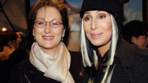 a close up of Meryl Streep, Cher posing for the camera