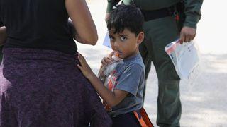 A family waits to be taken into custody