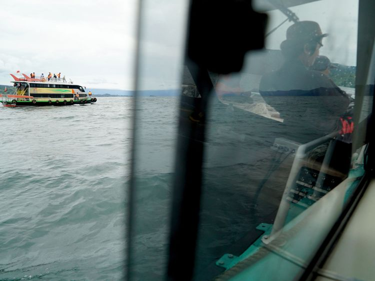 Rescue teams search for victims at the Lake Toba ferry port in the province of North Sumatra