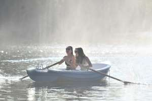 Sun lovers on a boating lake in London