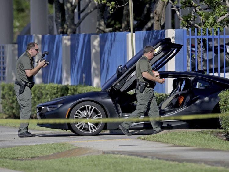 Investigators surround the car in which XXXTentacion was shot